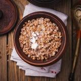 Freshly cooked buckwheat porridge in a clay pot Royalty Free Stock Photos