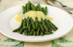 Freshly cooked green asparagus with hollandaise sauce Royalty Free Stock Photo
