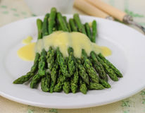 Freshly cooked green asparagus with hollandaise sauce Royalty Free Stock Images
