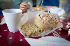 Traditional irish soda bread cooking and eating. Freshly cooked irish soda bread and a cup of coffee or tea for breakfast Stock Photos