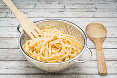 Freshly cooked linguine in a stainless steel colander Royalty Free Stock Image