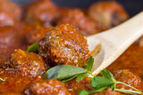 Freshly cooked meatballs in red sauce Stock Images