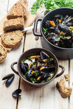 Freshly cooked mussels with garlic and parsley at home stock photography