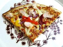 Freshly Cooked Pizza. Freshly cooked thin and crispy sweet chili chicken pizza stock photography