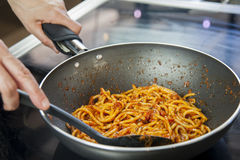 Freshly cooked spaghetti and stir-fried. With tomato and basil sauce Stock Photo