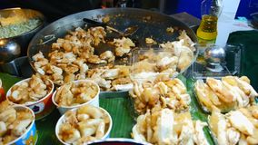 Freshly cooked stir-fried squid eggs for sale. stock footage