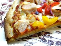 Freshly Cooked Pizza. Freshly cooked thin and crispy sweet chili chicken pizza royalty free stock photo