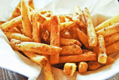 Freshly Crispy french fries with spices Royalty Free Stock Image