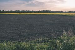Freshly cultivated agriculture fields ready for growing - vintage retro look. Freshly cultivated agriculture fields ready for growing food - vintage retro look royalty free stock image