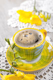 Freshly cup of espresso coffee  with flowers Royalty Free Stock Images