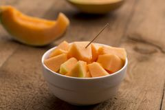 Cubes of freshly cut muskmelon Royalty Free Stock Images