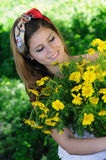 Freshly cut flowers in womans hand Royalty Free Stock Photography