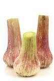 Freshly cut garlic bulbs Stock Images