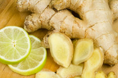 Freshly Cut Ginger Rhizome With Green Sweet Limes Royalty Free Stock Images