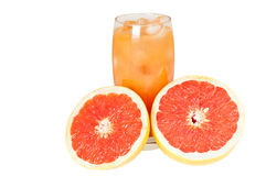 Freshly cut grapefruit and juice. Beautiful image of a freshly cut grapefruit and a glass of juice Stock Images