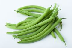 Freshly cut green beans photographed on white background royalty free stock image