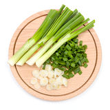Freshly cut green onion on cutting board Stock Photos
