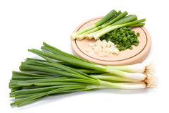 Freshly cut green onion on cutting board Royalty Free Stock Image
