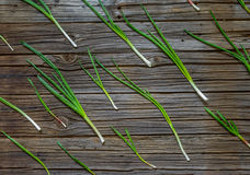 Freshly cut green onion displayed on wood table Royalty Free Stock Images