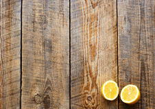Freshly cut half lemons on wooden boards Royalty Free Stock Images