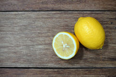 Freshly cut half and whole lemons Royalty Free Stock Photos