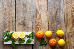 Freshly cut half and whole lemons on wooden boards Royalty Free Stock Images