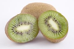 Freshly cut Kiwi Fruit. Kiwi fruit cut in half on a white background Stock Photo