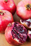 Freshly cut open pomegranate on wooden surface Stock Photography