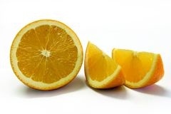 Freshly Cut Orange. Halves and Slices Royalty Free Stock Photo