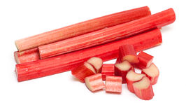 Freshly cut stems of rhubarb on a white background Royalty Free Stock Photo