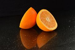 Freshly cutted orange. On a black background Stock Image