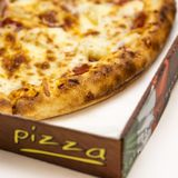 Freshly delivered hot pizza. Cheese and tomato pizza in delivery take out box Stock Image