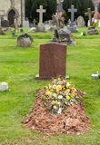 Freshly dug grave in cemetery royalty free stock photography