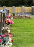 Freshly dug grave in cemetery Stock Photos