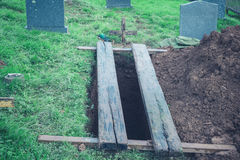 Freshly dug grave Stock Images