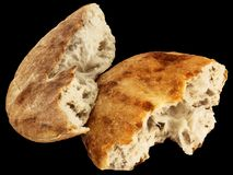 Freshly Fireplace Baked Domestic Traditional Aromatic Leavened Pitta Flatbread Torn Loaf Halves Isolated On Black Background. Freshly Fireplace Baked Domestic stock image