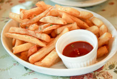 Freshly french fries with ketchup (tomato sauce) Royalty Free Stock Photo