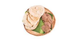Freshly fried and dried raw fish crackers on rattan tray Stock Photos