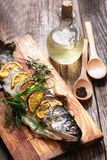 Freshly fried fish with vegetables. Fish-seafood-meals Royalty Free Stock Photography