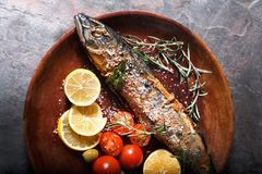 Freshly fried fish with vegetables and spices Stock Photo
