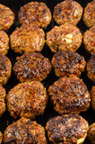 Freshly fried pork meatballs with onions Royalty Free Stock Images