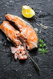 Freshly fried salmon served with lemon Royalty Free Stock Photo