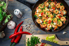 Freshly fried shrimps with herbs Royalty Free Stock Images