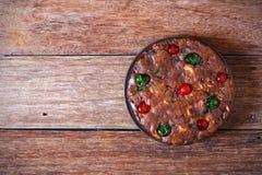 Freshly fruit cake on wood. Background Stock Photos