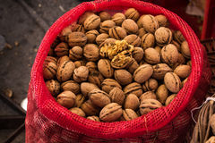 Freshly gathered Walnuts in a red sack Stock Image