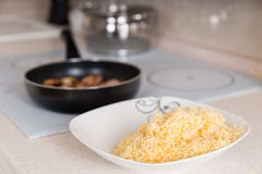 Freshly grated cheddar cheese in a bowl Stock Image