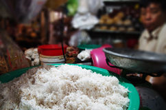 Freshly grated coconut at a market stall. Fresh grated coconut for sale at a market stall in Cambodia Stock Image
