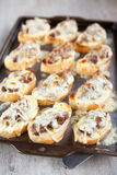 Freshly grilled bread topped with livers and cheese Royalty Free Stock Photography