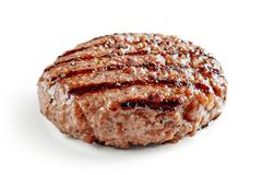 Freshly grilled burger meat. Isolated on white background royalty free stock photo