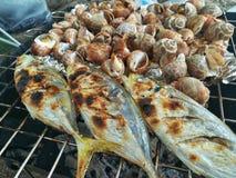 Freshly grilled seafood, shrimp, crab, fish, squid, shellfish. Thailand Stock Photo